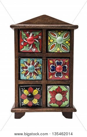 Small decorative stylish colorful printed oriental cupboard with foots with ceramic shelves on isolated background