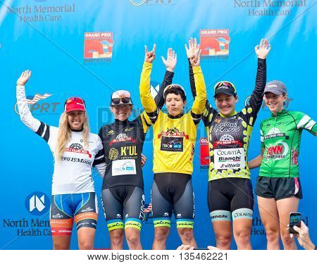 ST. PAUL, MINNESOTA - JUNE 15, 2016: Professional cycling competition winners atop podium at North Star Grand Prix stage one women's time trial in St. Paul on June 15.