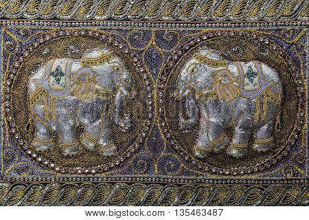 Antique handmade embroidered fabric with beads, ornaments, patterns, precious stones and two elephants in indian eastern oriental style