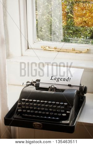 Legend! message against typewriter on a table