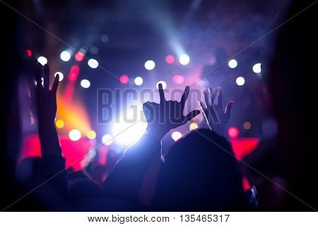 Crowd raising their hands on a music festival.