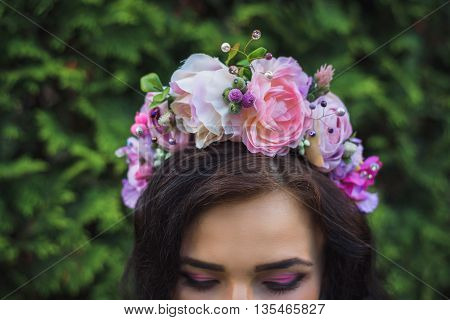 Attractive Young Woman With  Pink Flowers Crown