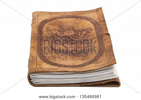Antique handmade embossed leather book with prints in indian eastern oriental style with a print of a sitting elephant