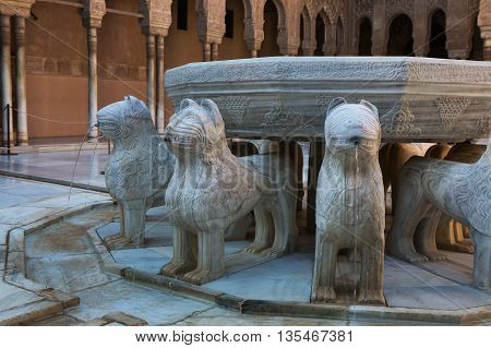 Detail of fountain in the Courtyard of the Lions. It is main courtyard of the Nasrid dynasty Palace of the Lions in fortress complex Alhambra in Granada. Spain