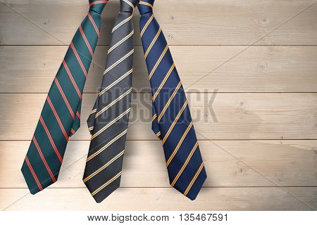 blue tie with diagonal line against bleached wooden planks background