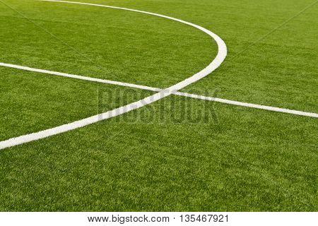 Lines on soccer field green grass. Abstract texture.