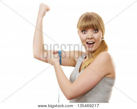 Woman Fit Girl With Measure Tape Measuring Her Biceps.
