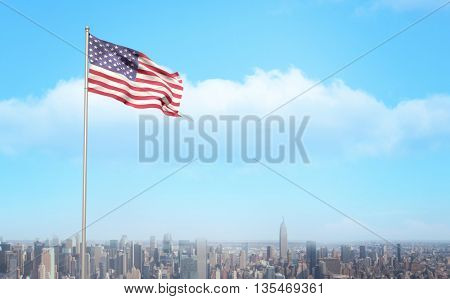 American flag waving on pole against image of a city landscape