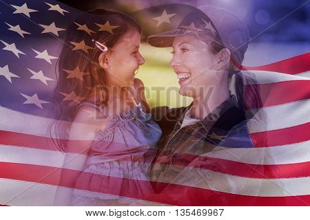 Digitally generated american flag rippling against a soldier mother hugging her daughter
