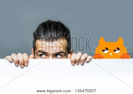 young man with scared eyes on emotional face with long hair behind white paper sheet with red cat on grey background copy space overlay image