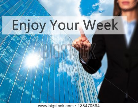 Enjoy Your Week  - Businesswoman Hand Pressing Button On Touch Screen Interface.