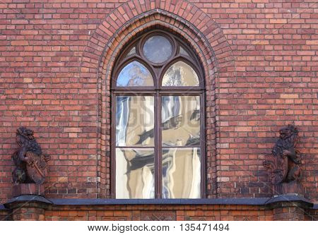 Window in old town building reflecting neighboring building in Riga, Latvia.