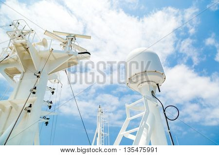 Sattelite communication antenna and radar mast of the cago ship.