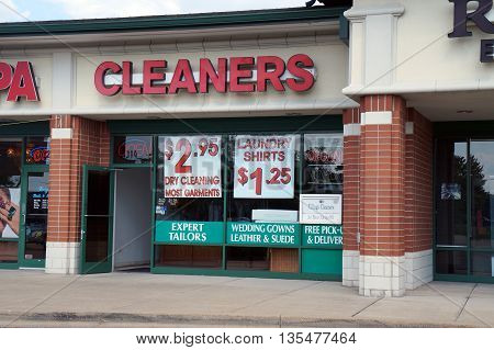 NAPERVILLE, ILLINOIS / UNITED STATES - JULY 23, 2015: One may have one's clothes cleaned at the Village Cleaners, in a Naperville strip mall.
