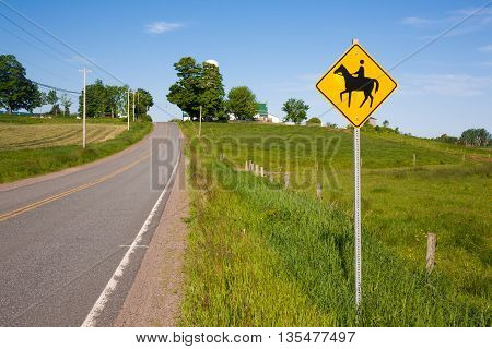 Horse crossing sign on a rural road.