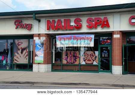 NAPERVILLE, ILLINOIS / UNITED STATES - JULY 23, 2015: One may have one's nails trimmed at the Foxy Nails & Spa, in a Naperville strip mall.