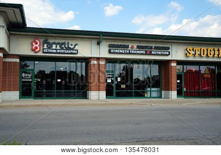 NAPERVILLE, ILLINOIS / UNITED STATES - JULY 23, 2015: Farrell's Extreme Body Shaping offers fitness programs in a Naperville strip mall.