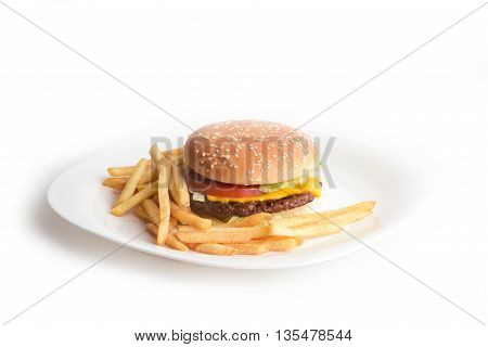Fresh tasty hamburger with cheese, slice of tomato and french fries on a white plate isolated on white background