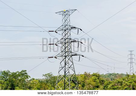 High voltage pole in green valley in thailand