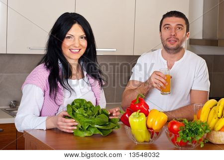 Cheerful Couple In Kitchen Preparing Food