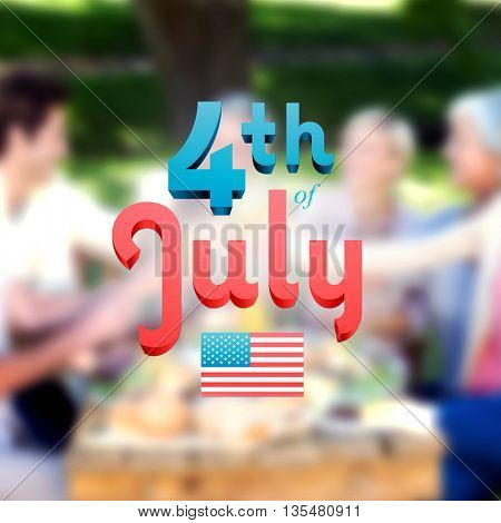 Independence day graphic against happy family toasting in the park