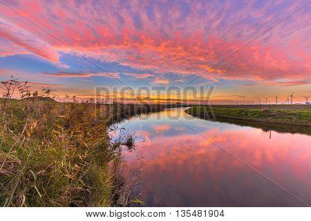 Dutch River Sunset In Bright Colors