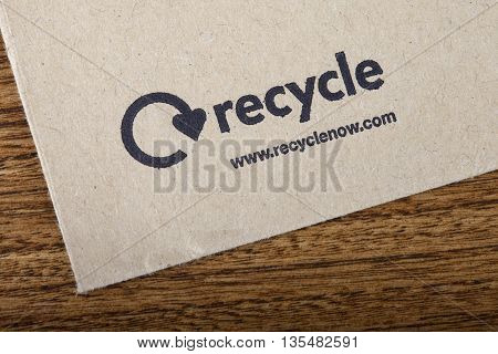 LONDON UK - JUNE 13TH 2016: Close-up of the official Recycle Now symbol on the back of an envelope taken in London on 13th June 2016. Recycle Now is a national recycling campaign funded by the government in England.