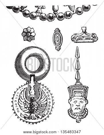 Ancient Assyrian jewels and earrings, found in Nineveh in Iraq,  preserved at the Louvre Museum. From Fine Arts Book, vintage engraving, 1880.
