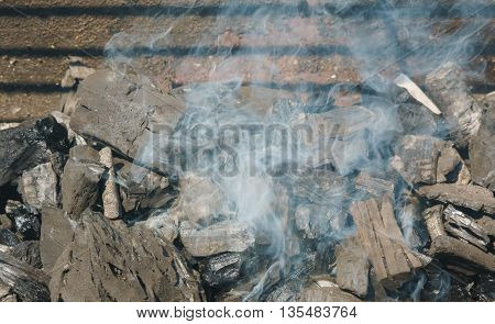 Glowing coals in a barbeque grill coal fire smoke