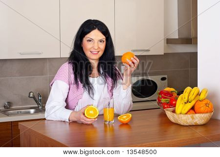 Woman Make Fresh Orange Juice