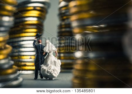 Bride and groom walking on the road, surrounded by money