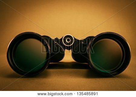 black color binoculars and gray color background