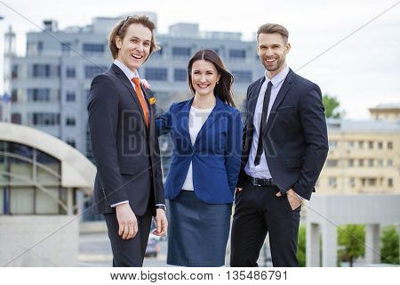 Three Business people outside office