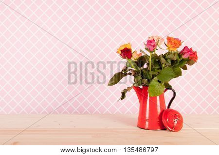 Colorful bouquet roses in pink interior