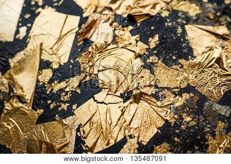 abstract gold leaf sticked on black statue