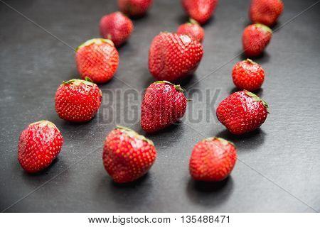 Strawberries series put on black slate background