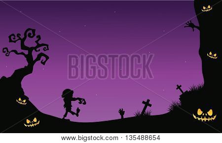 Zombie in graveyard Halloween silhouette with purple backgrounds