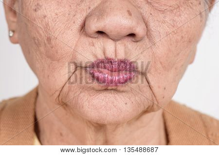 closeup mouth of elderly woman, healthy concept