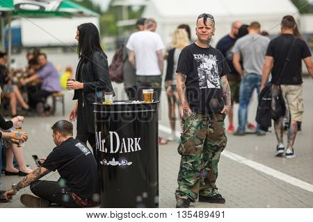 KRAKOW, POLAND - JUNE 11, 2016: Unidentified festival participants at the 11-th International Tattoo Convention in the Congress-EXPO Center of Krakow.