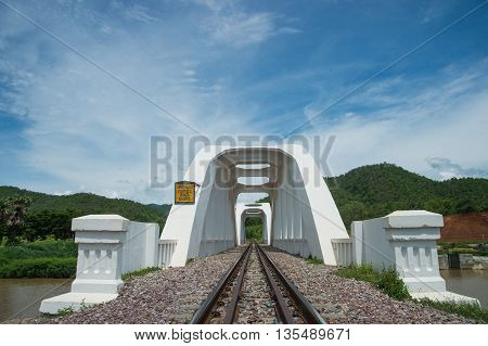 Old white railway bridge at Lamphun Thailand.