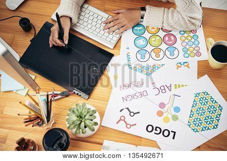Close-up of creative designer using pen tablet