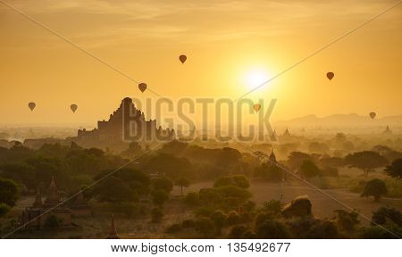 Hot air balloon over plain of Bagan in misty morning Myanmar