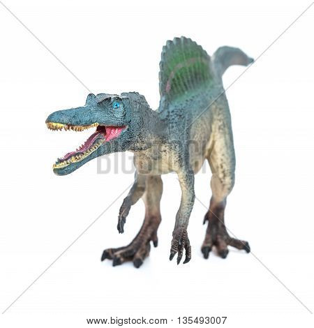 grey grey spinosaurus toy on a white background