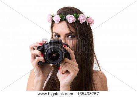 Beautiful latina girl holding DSLR camera on white background