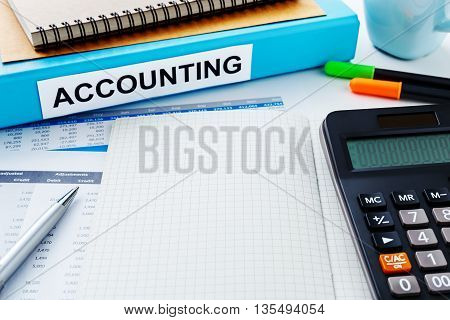 Accounting Work Desk With Blank Notebook