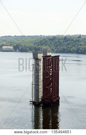 Unfinished bridge bearing in the Dnipro river
