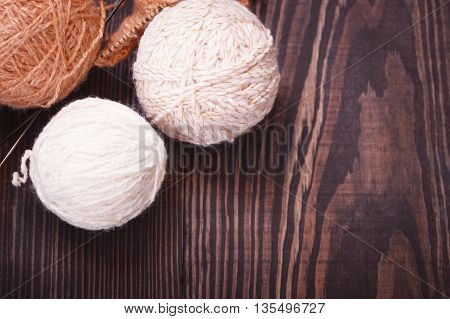 Skeins of wool thread for knitting on a table