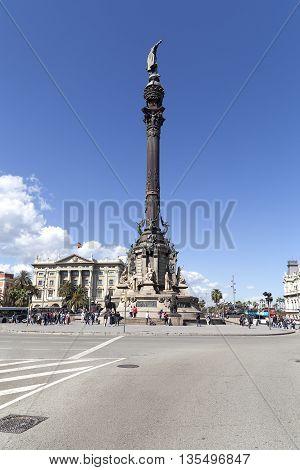 BARCELONA SPAIN - MAY 11, 2016 : Columbus Monument on Placa Portal de la Pau Barcelona Spain. Bronze statue sculpted by Rafael Atche situated on top of a 40-meter Corinthian column.