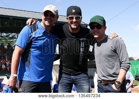 ARLINGTON, TX - APR 18: (L-R) Storme Warren, Luke Bryan and Justin Moore at the ACM & Cabela'??s Great Outdoor Archery Event at the Texas Rangers Youth Ballpark on April 18, 2015.