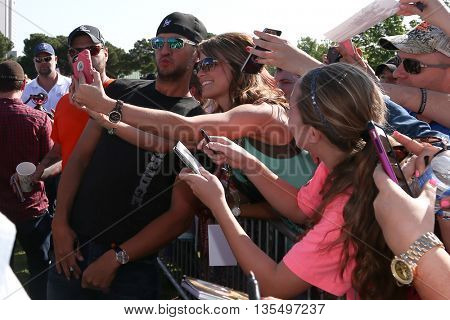 ARLINGTON, TX - APR 18: Singer Luke Bryan takes a selfie with a fan at the ACM & Cabela'??s Great Outdoor Archery Event at the Texas Rangers Youth Ballpark on April 18, 2015.